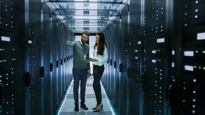 Man and woman talking in server room