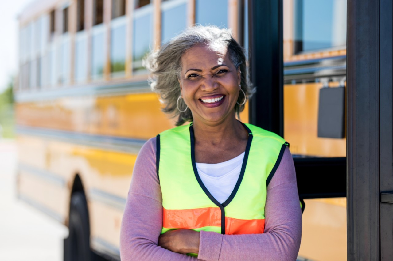 Woman standing in front of a school bus